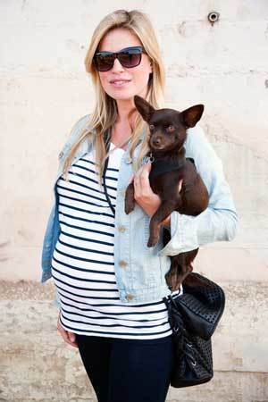 """By Colin Young-Wolff """"I got this entire outfit from Gap because it's cheap maternity,"""" says Melissa Keller, 32 of Silver Lake, posing with her 1-year-old chihuahua, Pepper Bear. """"I don't wear your really nice clothes. I always get trashed at the dog park. One of my dogs likes to roll in mud and then she comes in the car and tries to get on my lap."""""""