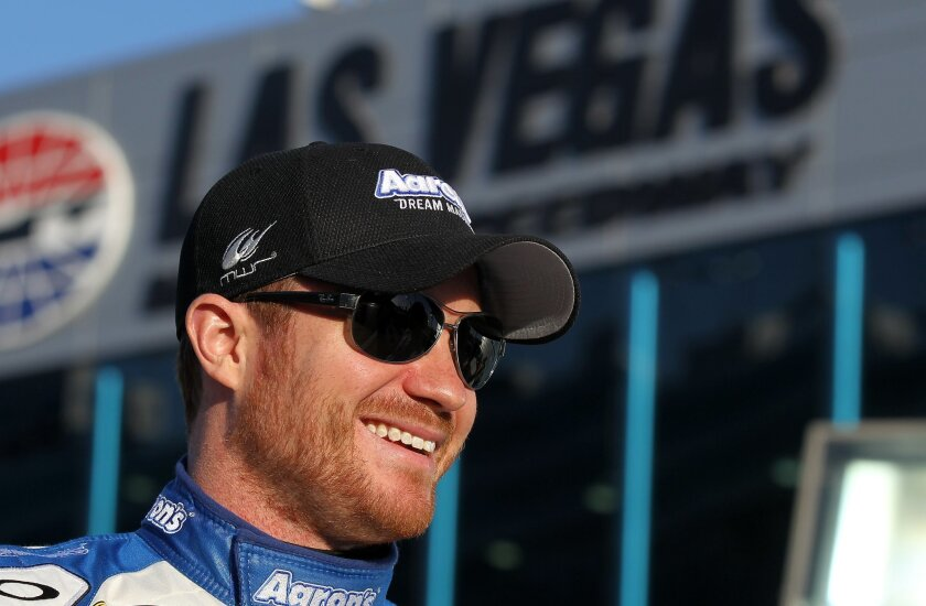 FILE- In this March 6, 2015, file photo, driver Brian Vickers prepares for qualifying for the NASCAR Sprint Cup Series auto race in Las Vegas. According to a person familiar with the situation, The Associated Press has learned, Wednesday, Feb. 10, 2016, that Vickers will replace injured driver Tony