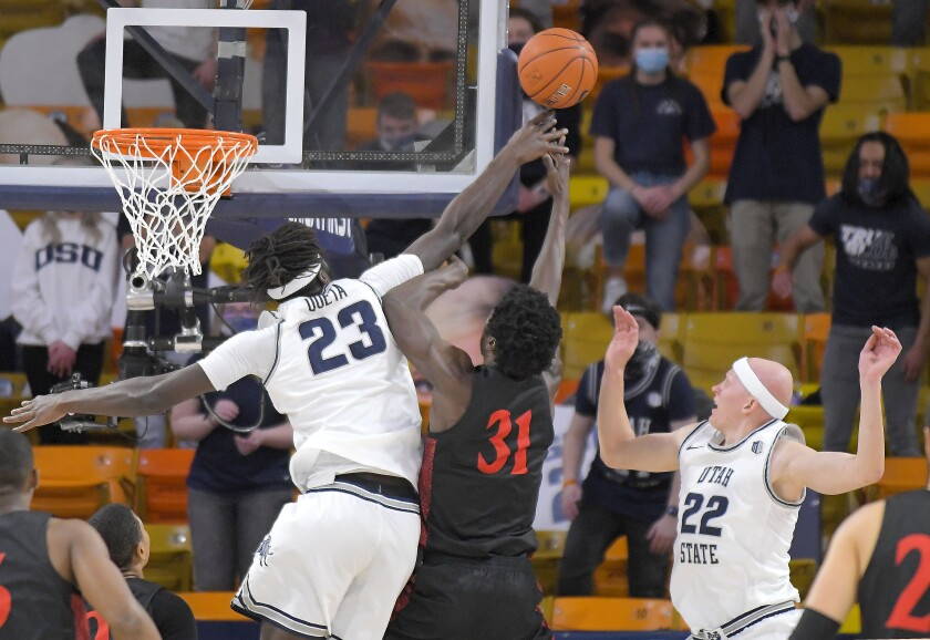 Utah State center Neemias Queta (23) blocks the shot of SDSU's Nathan Mensah (31) in Saturday's game in Logan, Utah.