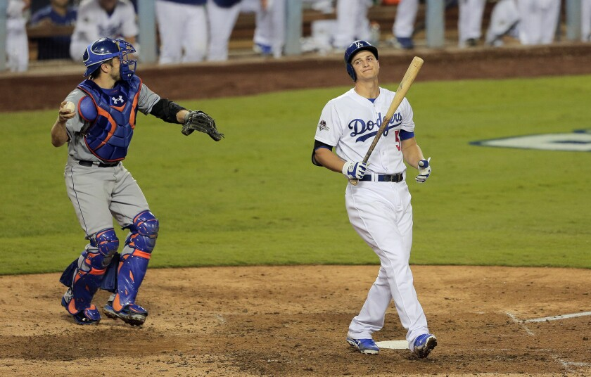 Dodgers shortstop Corey Seager reacts after striking out in the seventh inning of Game 5.