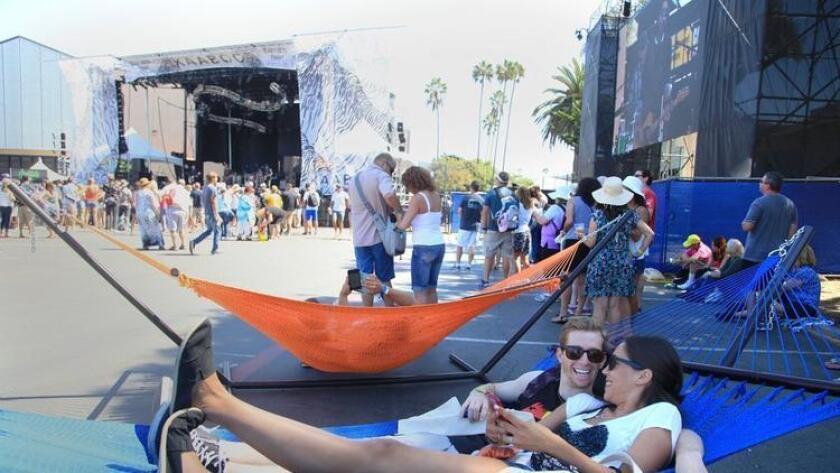 SAN DIEGO, CA-SEPTEMBER 18, 2015: Alec Stone and Julia Redmond of Huntington Beach lay on a hammock at the KAABOO Del Mar festival Friday. (Misael Virgen / San Diego Union-Tribune) - Misael Virgen
