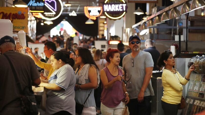 LOS ANGELES, CA OCTOBER 27, 2017 -- Patrons wind their way through Grand Central Market in downtown