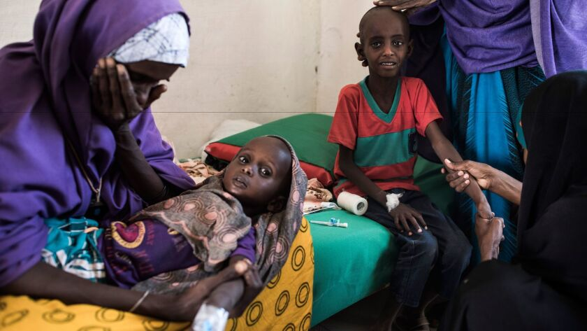 Somali mothers seek treatment for malnourished children. Drought is threatening millions across the country, the United Nations says.