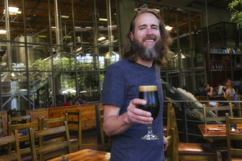 Greg Koch, Co-founder/Executive Chairman of Stone Brewing in the dining room. (Nelvin C. Cepeda/U-T)