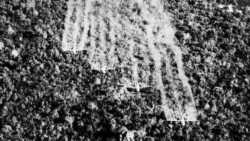 "A photo provided by the U.S. Air Force shows four ""Ranch Hand"" C-123 aircraft spraying liquid defoli"