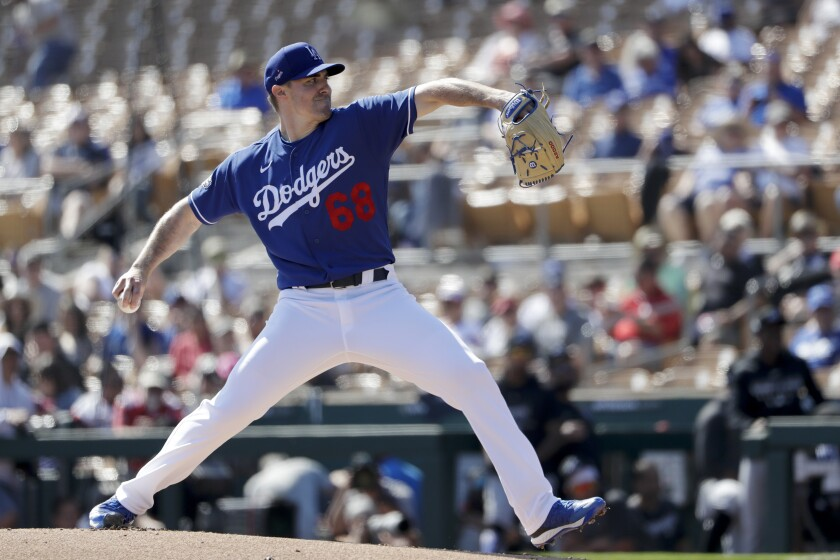 Dodgers starting pitcher Ross Stripling works against a Chicago White Sox batter during the first inning of a spring training baseball on Monday in Phoenix.