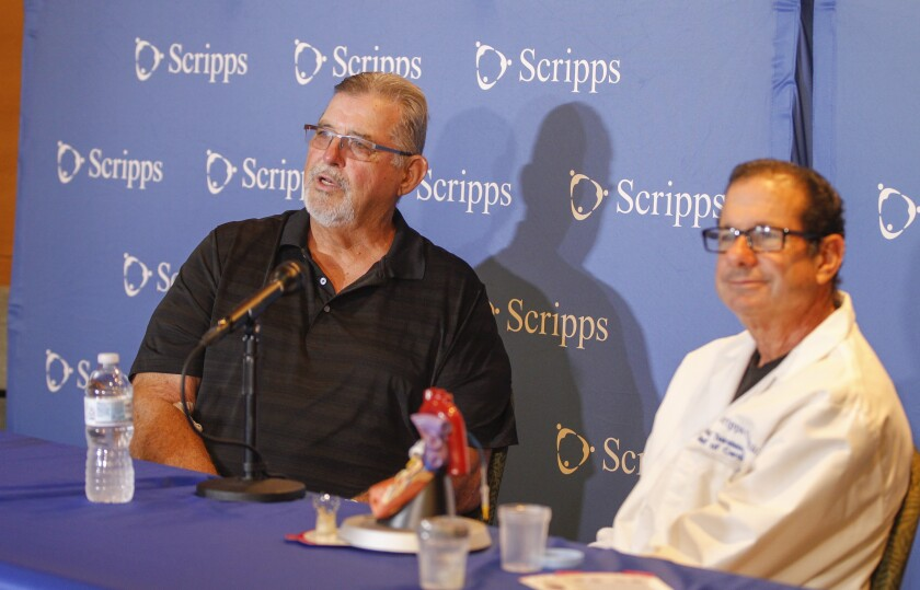 NFL great Ed White (left) and Dr. Paul Teirstein (right) hold a press conference to announce the successful new heart valve operation for White on Wednesday at Scripps La Jolla.