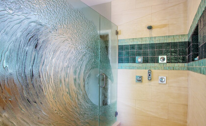 The master shower with tidal wave glass door at the home of Ryan Christenson in Encinitas.