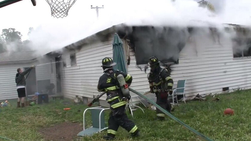 Firefighters battle a house fire at 827 Stella St. in Vallejo.