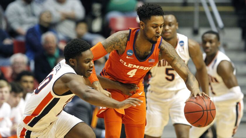 Clemson's Shelton Mitchell (right) steals the ball from Auburn's Davion Mitchell during NCAA Tournament action on Sunday, March 18, 2018 at Viejas Arena.