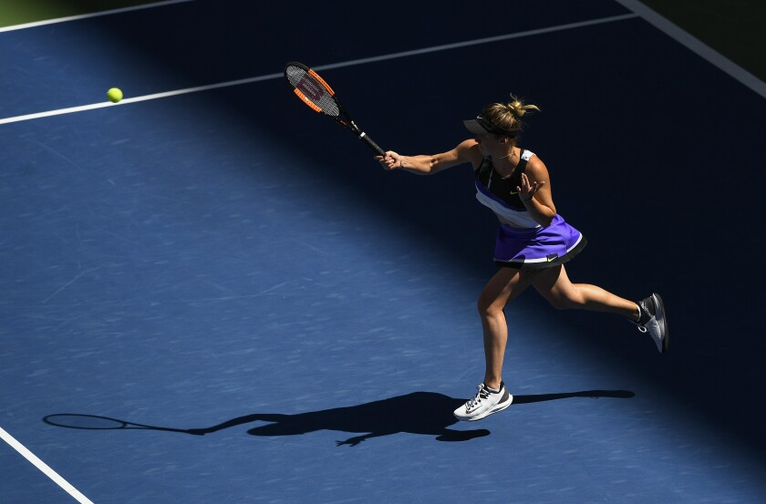 Elina Svitolina returns a shot to Johanna Konta during the quarterfinals of the U.S. Open on Tuesday.