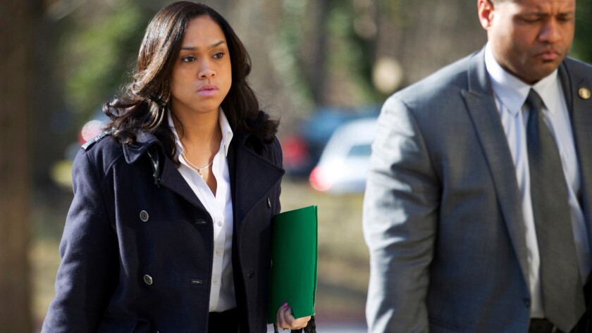 Baltimore State's Atty. Marilyn J. Mosby arrives a courthouse.