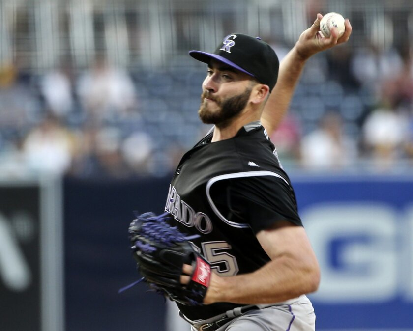 Colorado Rockies starting pitcher Chad Bettis throws against the San Diego Padres in the first inning of a baseball game Saturday, June 4, 2016, in San Diego. (AP Photo/Lenny Ignelzi)