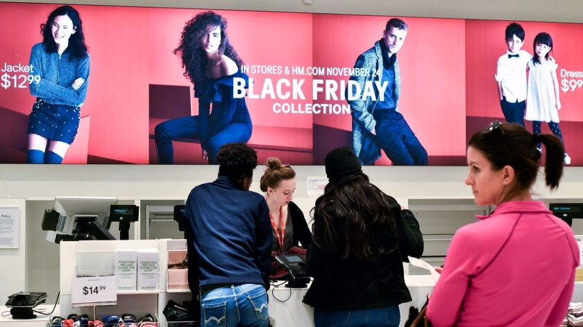 People make purchases at H&M in Tyler, Texas, on Wednesday, Nov. 22, 2017. Stores in Tyler are marki