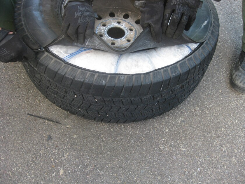 Border Patrol agents discovered baggies filled with meth inside the spare tire of an SUV on Friday.