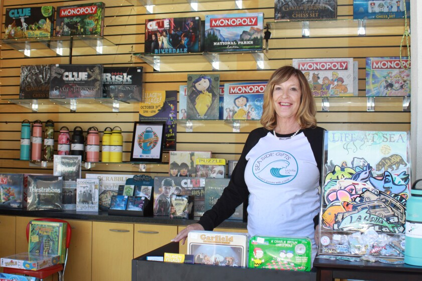 "After operating her business distributing City- and themed- ""Monopoly"" and ""Clue"" games for more than two decades, La Jolla resident Shawn Chapin has opened her first pop-up stand a few weeks ago to offer specialty board games, specialty water bottles, stickers that read ""La Jolla"" with proceeds that go toward ocean clean-ups and more. It is a kiosk located on the corner of Herschel Avenue and Prospect Street. ""I'm licensed by Hasbro to produce these games, and I started 25 years ago with La Jolla-opoly,"" she said. ""Now we have 'Game of Thrones' and 'It' Monopoly games that are really popular. I decided to open a pop-up because I live in La Jolla and thought this was a great location, and everyone loves games. There is nothing like this in town, so we're excited to roll the dice!"""