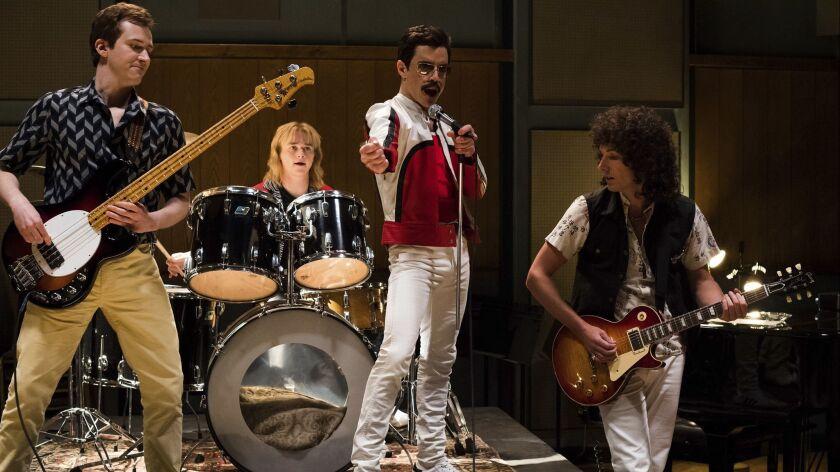 """Joe Mazzello, from left, Ben Hardy, Rami Malek and Gwilym Lee in a scene from 20th Century Fox's """"Bohemian Rhapsody."""""""