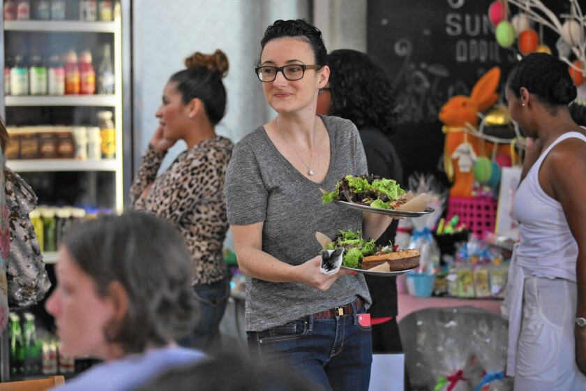 Holly Jones serves customers at a new restaurant on Lincoln Boulevard in northwest Pasadena.