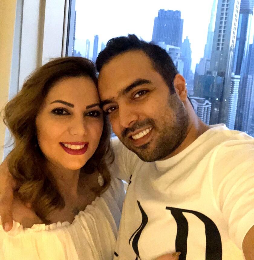 Nima Embrahimi, right, with his fiancee Moojan Mirbaha, who lives in Texas.