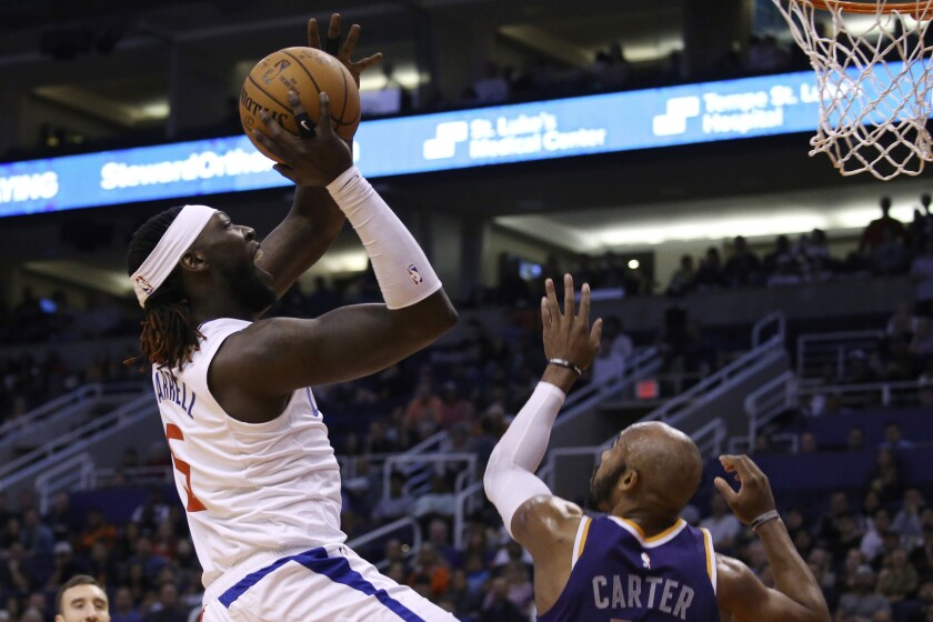 The Clippers' Montrezl Harrell, who scored a team-best 28 points, shoots over the Suns' Jevon Carter on Saturday night.