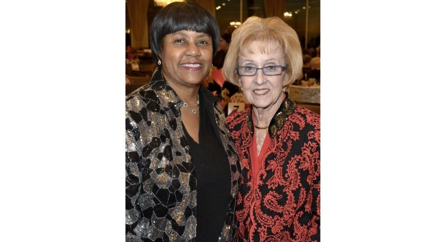 La Providencia Guild President Glenda Jones, left, and the event Chairwoman Lynn White-Shelby, welco