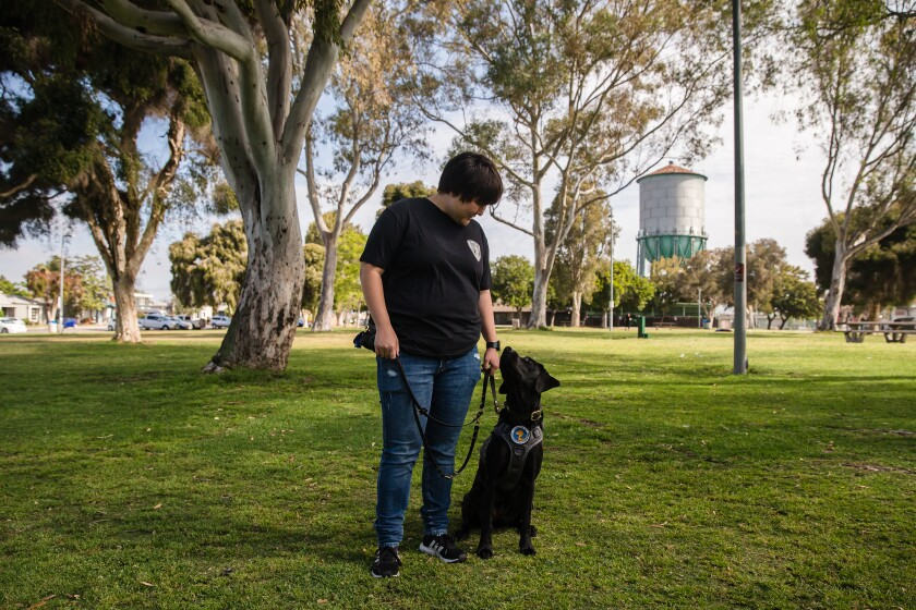 Marine veteran Jessica Belcher's was paired with service dog, Lucy, who helps her cope with post-traumatic stress disorder.