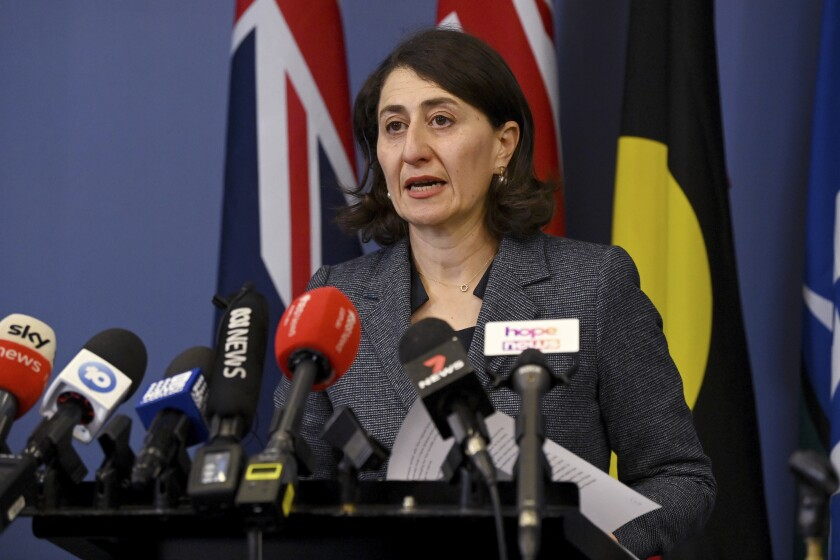 New South Wales Premier Gladys Berejiklian announces her resignation in Sydney, Friday, Oct. 1, 2021. The leader of Australia's most populous state quit as premier after an anti-corruption watchdog revealed it was investigating her over a secret relationship with a former lawmaker. (Bianca De Marchi/AAP Image via AP)