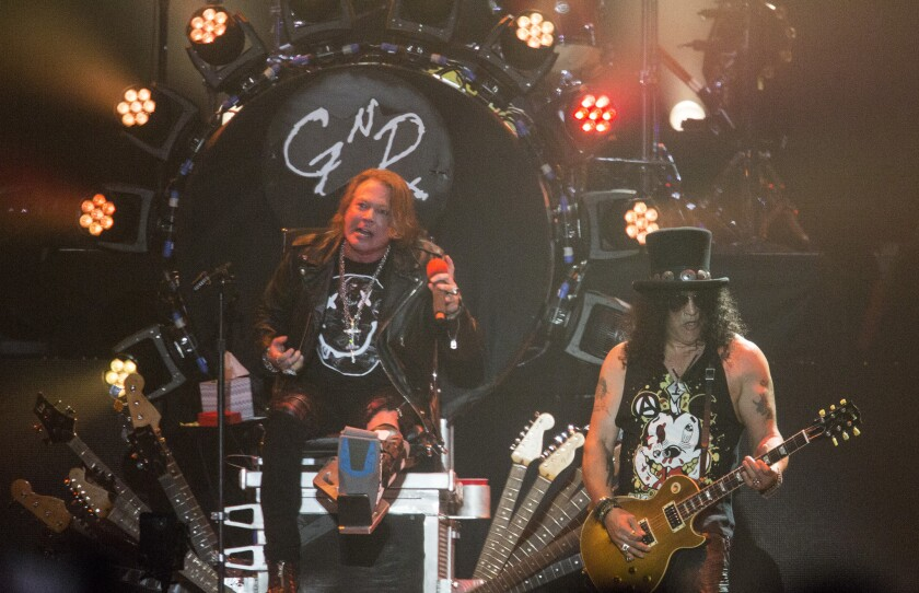 Axl Rose, left, and Slash, together for the Guns N' Roses reunion at Coachella.