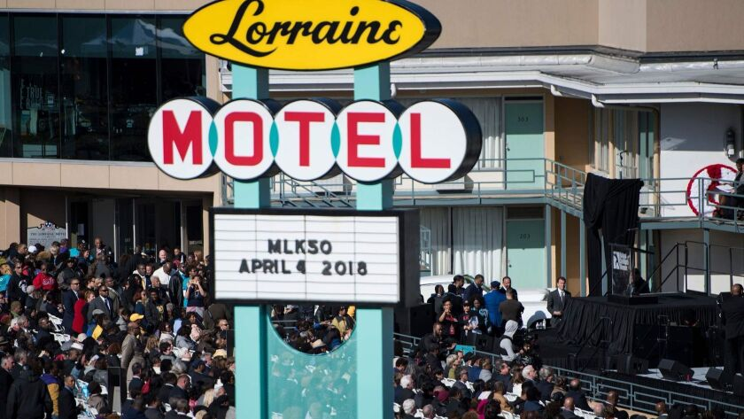 People listen to speakers during an event at the Lorraine Motel commemorating the 50th anniversary of the assassination of Martin Luther King Jr. on April 4 in Memphis, Tenn.