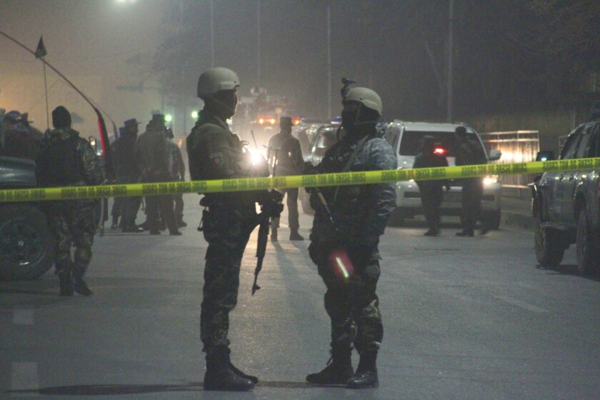 Police stand guard after a suicide bombing at a French-run high school in Kabul, Afghanistan, last year. In January, the International School of Kabul, which taught classes in English, said it was closing because of an unspecified threat.