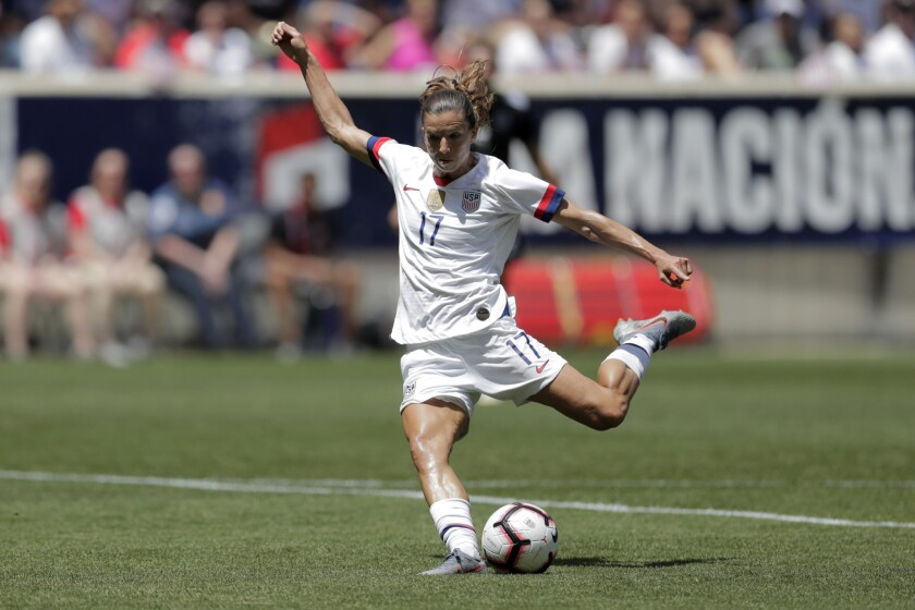 Unites States forward Tobin Heath shoots a scoring shot against Mexico during the first half of an i