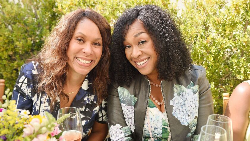 """Channing Dungey and Shonda Rhimes at Glamour x Tory Burch's """"Women to Watch"""" lunch."""