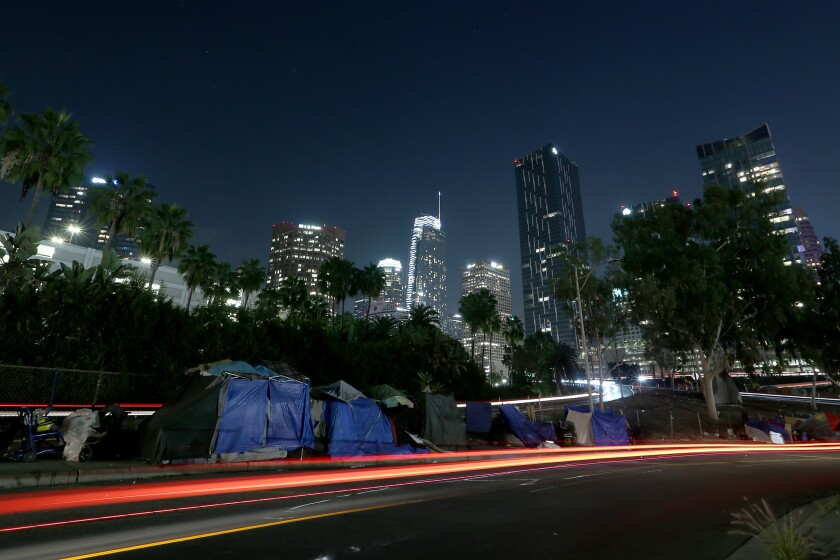 A homeless encampment lines James M. Wood Street in downtown L.A. on Dec. 30.