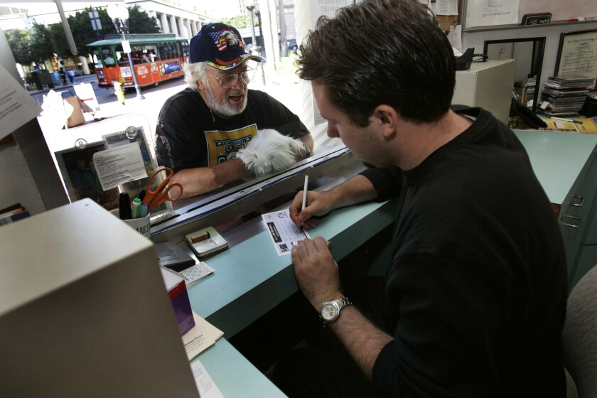 An Arts tix client buys tickets to a play at the Horton Plaza location in 2004.