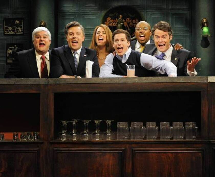 """Bobby Moynihan, left, Jason Sudeikis, Kristen Wiig, Andy Samberg, Kenan Thompson and Bill Hader deliver the goods on a """"Saturday Night Live"""" episode."""