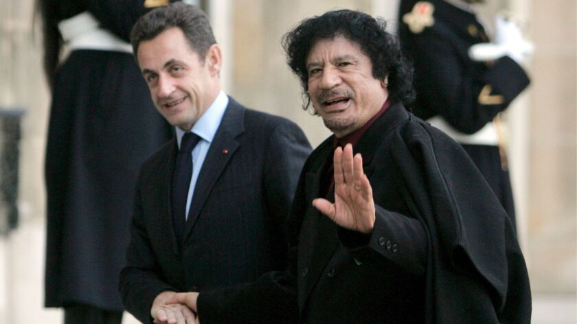 French President Nicolas Sarkozy, left, welcomes Libyan leader Moammar Kadafi to Paris on Dec. 12, 2007.