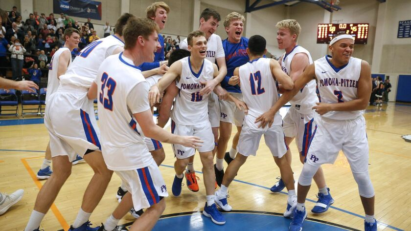 The Pomona-Pitzer Sagehens celebrate their win over the Occidental Tigers in the Southern California Intercollegiate Athletic Conference championship game Feb. 23 at Voelkel Gym.