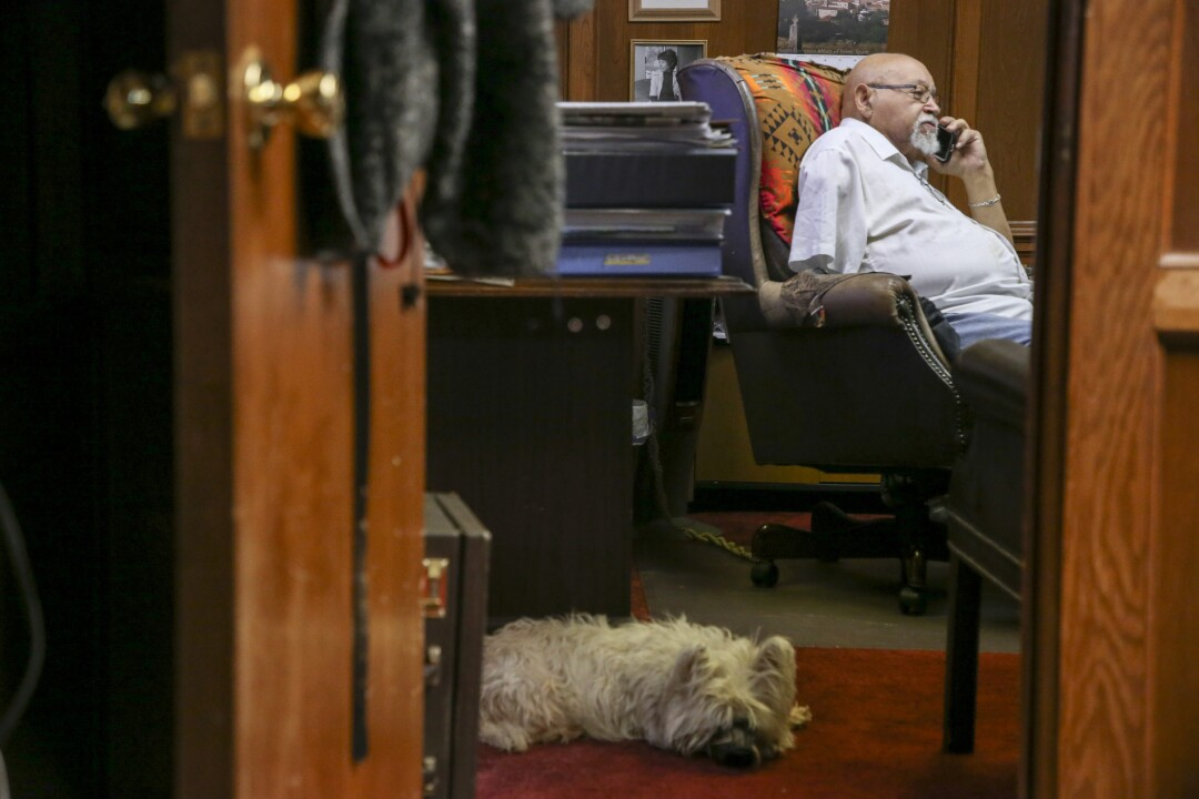 Jim Goodwin and Annie the Westie inside the Oklahoma Eagle offices.