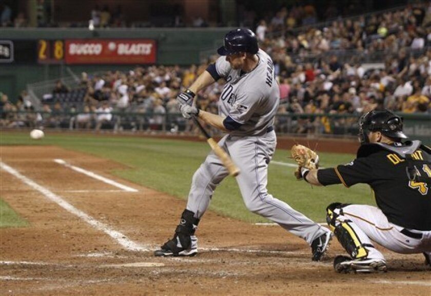 San Diego Padres' Chase Headley, left, hits a single in the eighth inning of a baseball game against the Pittsburgh Pirates on Friday, Aug. 5, 2011, in Pittsburgh. Headley had also hit a grand slam in the fourth inning, leading the Padres to 1 5-5 win. (AP Photo/Keith Srakocic)