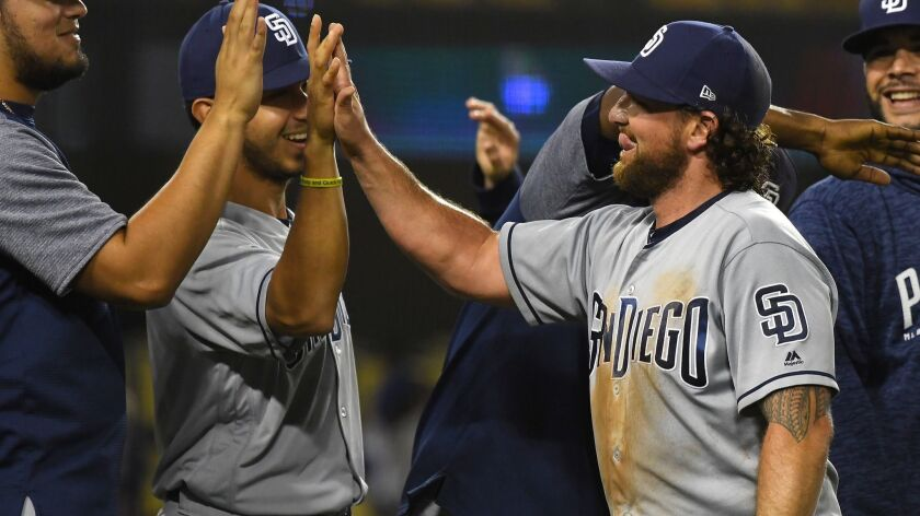 Kirby Yates gets high fives as he walked off the field after earning a save against the Dodgers on Friday night.