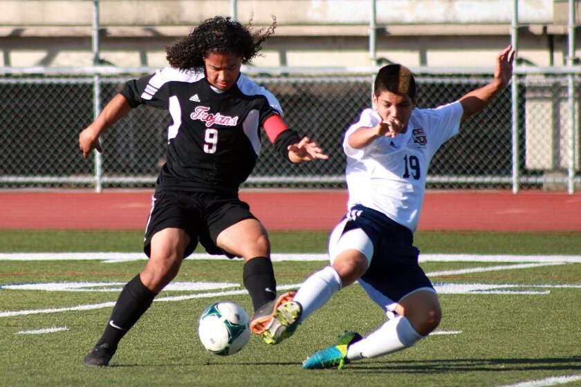 Castle Park High senior Felipe Liborio Jr. (left) fakes Montgomery junior David Mendoza during a match last week. Castle Park beat Montgomery 1-0.