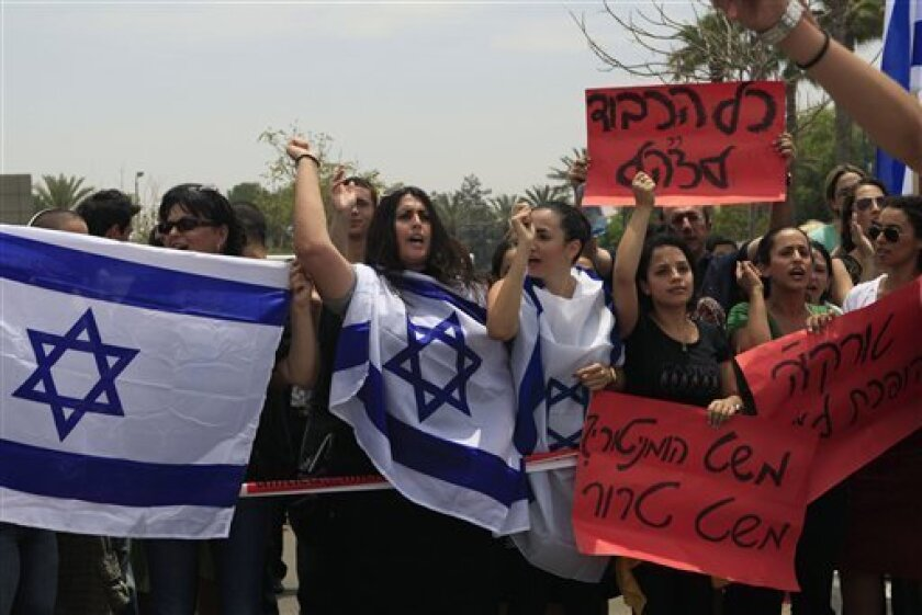 Israelis demonstrate  in support of Israel following a deadly raid by Israel's navy on an aid flotilla bound for the blockaded Gaza Strip, in the southern city of Ashkelon, Israel, Tuesday, June 1, 2010. Pro-Palestinian activists on Tuesday sent another boat to challenge Israel's blockade of the Ga