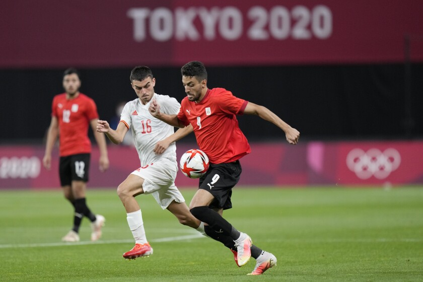 Spain's Pedri Gonzalez, left, and Egypt's Taher Mohamed battle for the ball during a men's soccer match at the 2020 Summer Olympics, Thursday, July 22, 2021, in Sapporo, Japan. (AP Photo/SIlvia Izquierdo)