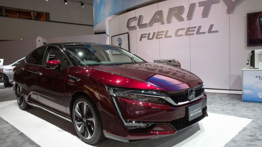 GM and Honda will pool their resources to build hydrogen fuel cell systems to power vehicles like Honda's Clarity.