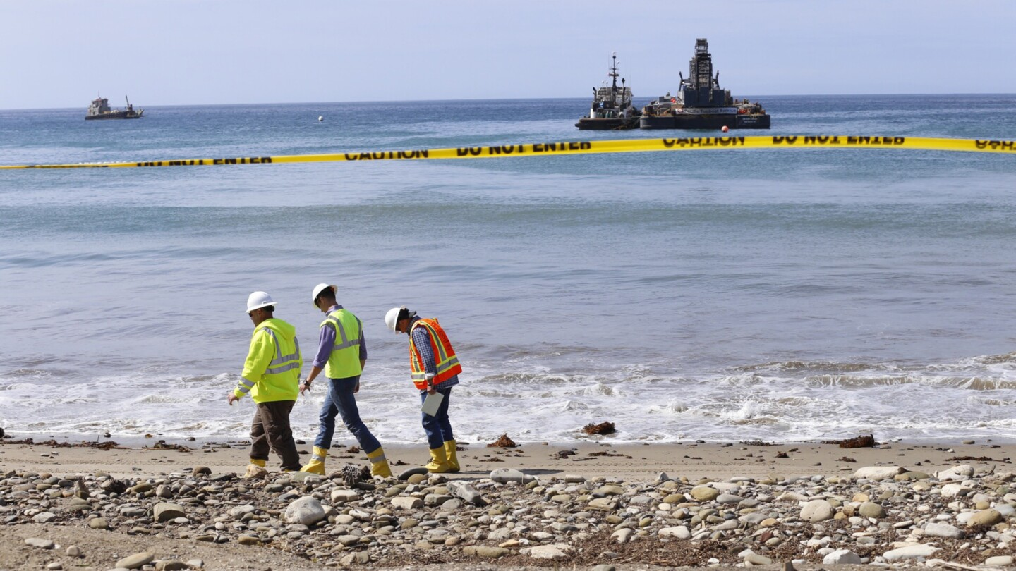 With boats offshore, cleanup efforts continue at Refugio State Beach on Thursday morning June 4, 2015.