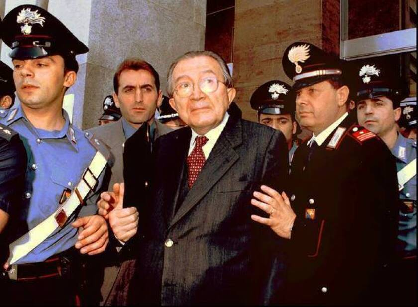 Former Italian Prime Minister Giulio Andreotti, center, is shown leaving court in 1996. The seven-time prime minister dominated post-World War II politics, but was tainted by allegations of Mafia ties. Andreotti has died at age 94.