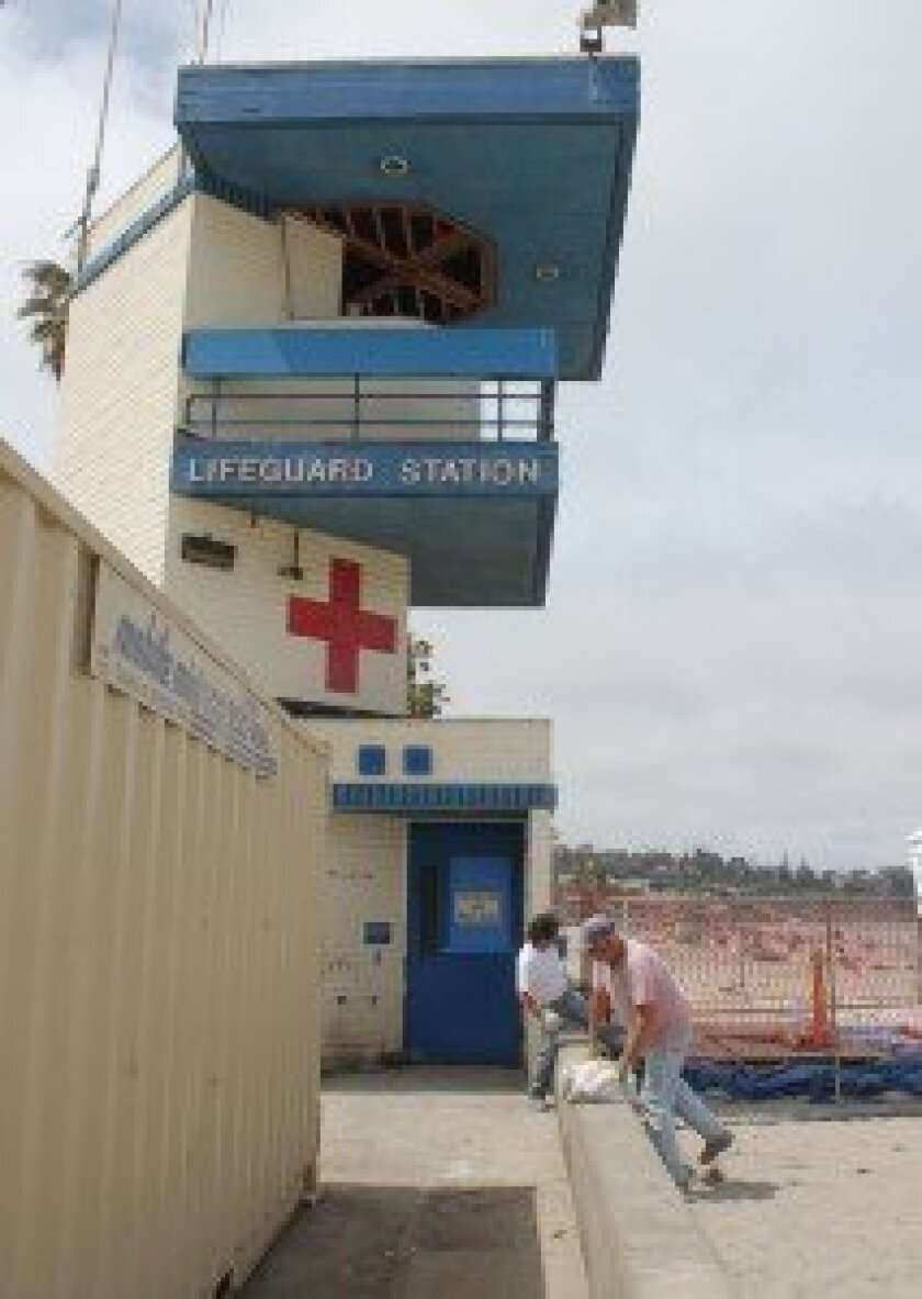 Workers are busy demolishing the old lifeguard tower at La Jolla Shores.