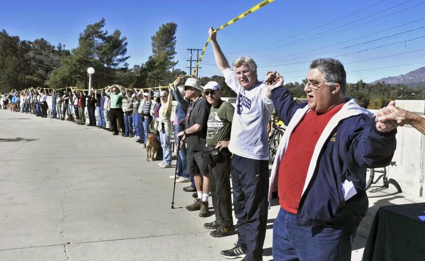Protest at Devil's Gate Dam sediment removal project