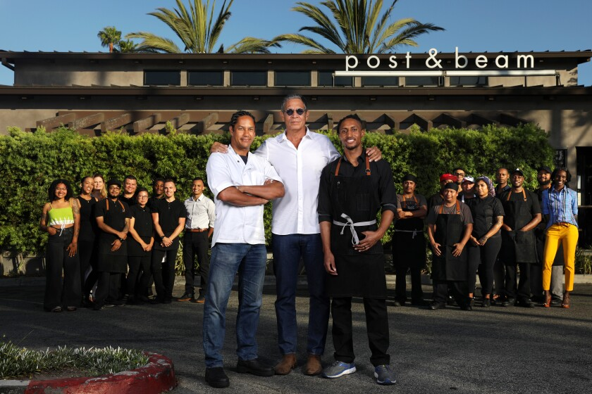 BALDWIN HILLS-CA-JULY 19, 2019: Restauranteur Brad Johnson (C), chef-owner John Cleveland (R) and chef-consultant Govind Armstrong (L) are photographed with staff at Post & Beam restaurant in Baldwin Hills on Thursday, July 19, 2019. (Christina House / Los Angeles Times)