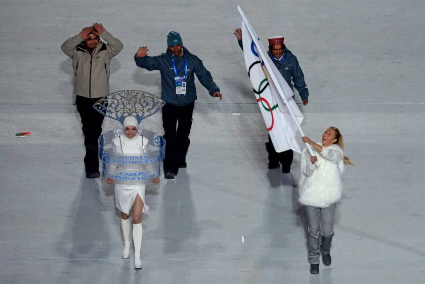 India luger Shiva Keshavan, top left, cross-country skier Naddem Iqbal, top center, and alpine skier Himanshu Thakur, top right, march in the Sochi Olympics opening ceremony as independent athletes.